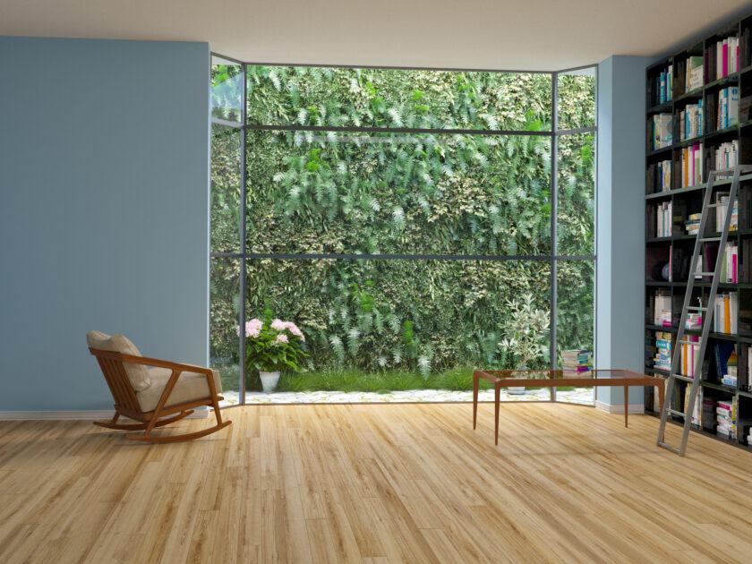 壁面緑化とそれが見える部屋の椅子